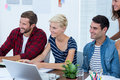 Creative business team using laptop in meeting happy at office Royalty Free Stock Photos