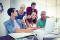 Creative business team using laptop in meeting Royalty Free Stock Photo