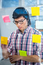 Creative businessman writing on sticky notes Royalty Free Stock Photo