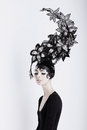 Creative concept futuristic woman in art fabulous headdress portrait of Royalty Free Stock Image