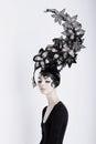 Creative Concept. Futuristic Woman in Art Fabulous Headdress