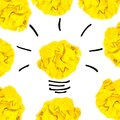 Creative concept. Yellow light bulb made of yellow crumpled, pap Royalty Free Stock Photo