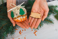 Creative diy hobby handmade craft christmas decoration ball with tree woman shows felt spruce and empty wooden lable copy space Royalty Free Stock Images