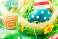 Creative eggs in basket group of the easter selective focus on the dotted blue egg Stock Photography