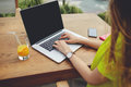 Creative female freelancer sitting front laptop computer with blank copy space screen for your information young business woman Stock Photography