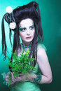 Creative girl spring fairy young woman in green dress and with artistic visage and hairstyle Royalty Free Stock Photos