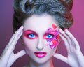 Creative girl young woman with make up with red and pink hearts Stock Photography