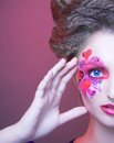 Creative girl young woman with make up with red and pink hearts Stock Photos