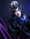 Creative lady dark queen young woman in halloween image posing with mask Royalty Free Stock Images
