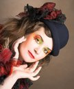 Creative lady portrait of pretty in vintage hat and with artistic make up Stock Image