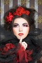 Creative lady queen of hearts in black and red colors and with bright make up Royalty Free Stock Photos