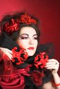 Creative lady queen of hearts in black and red colors and with bright make up Royalty Free Stock Images