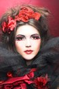 Creative lady queen of hearts in black and red colors and with bright make up Stock Images