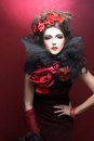 Creative lady queen of hearts in black and red colors and with bright make up Stock Photo