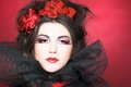 Creative lady queen of hearts in black and red colors and with bright make up Royalty Free Stock Photography