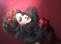 Creative lady queen of hearts in black and red colors and with bright make up Stock Image