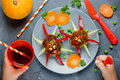 Creative lunch for your child spider cutlet with vegetables Royalty Free Stock Photo