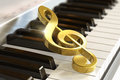 Creative musical concept macro view golden shiny treble clef piano synthesizer keyboard selective focus effect Stock Photos