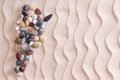 Creative pebble map of Argentina on beach sand Royalty Free Stock Photo