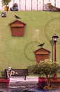 Creative photo manipulation artwork with retro look of relaxing animals and mailboxes on green wall Stock Photo