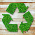 Recycle symbol from grass on wood background Royalty Free Stock Photo
