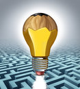 Creative solution business concept as a pencil shaped as a three dimensional lightbulb erasing a clear path through a maze puzzle Stock Images