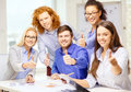 Creative team with papers showing thumbs up business office and startup concept and clipboard Stock Image