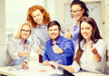 Creative team with papers showing thumbs up business office and startup concept and clipboard Royalty Free Stock Image