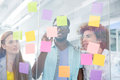 Creative team writing on adhesive notes business in office Stock Photos