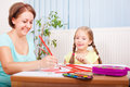 Creativeness mother and daughter drawing at their comfortable home Royalty Free Stock Photography