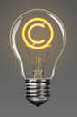 Creativity copyright bulb with glowing sign inside of it concept Stock Image