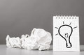 Creativity creative process crumpled wads and notebook with bulb picture Royalty Free Stock Photography