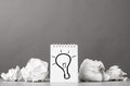 Creativity creative process crumpled wads and notebook with bulb picture Stock Photography