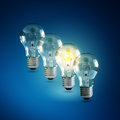 Creativity and innovation illuminated light bulb in a row of dim ones concept for solution Stock Images