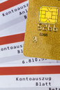 Credit card and bank statement a gold symbolic photo for cashless transactions status symbols Stock Photography