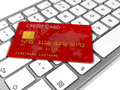 Credit card on a computer keyboard Royalty Free Stock Image