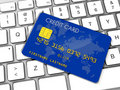 Credit card on a computer keyboard Stock Image