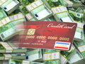 Credit card on euro packs background. Royalty Free Stock Images