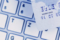 Credit card and keyboard close up a for cashless payment photo icon for shopping on the internet Royalty Free Stock Images