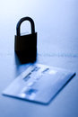 Credit card security monochromatic shallow depth of field shot featuring silhouette of an locked padlock close to a concept of Royalty Free Stock Image