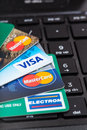 Credit cards on black computer keyboard Royalty Free Stock Photo