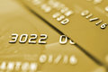 Credit cards golden tone macro shot selective focus Royalty Free Stock Images