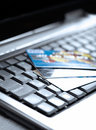 Credit cards and laptop Stock Images