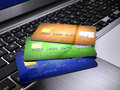 Credit cards on laptop keyboard Royalty Free Stock Photos