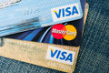 Credit cards photo of visa and mastercard on blue jeans Stock Image