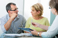 Credit counseling mature couple getting financial advice from consultant at home Stock Photos