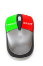 Credit and debit concept using a mouse with green red colors Royalty Free Stock Photos