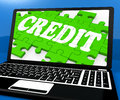 Credit Puzzle On Notebook Shows Online Purchases Royalty Free Stock Photo