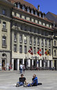 Credit suiss bank in bern switzerland may young students rest near on the bundesplatz square on may the Royalty Free Stock Images
