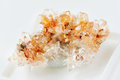 Creedite crystal cluster orange from mexico close up on a white background Royalty Free Stock Image